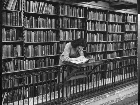 alfred-eisenstaedt-woman-reading-book-among-shelves-on-balcony-in-american-history-room-in-new-york-public-library