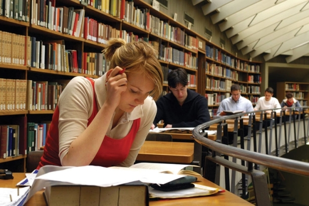 students_studying_in_university_library