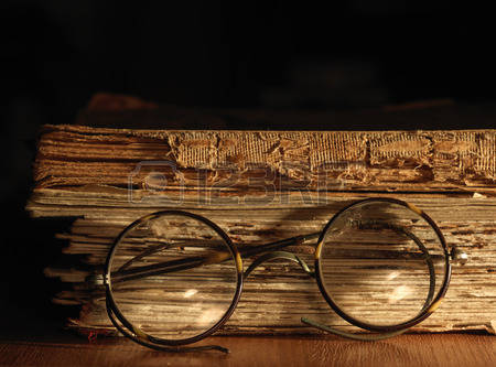 41067512-antique-glasses-on-old-weathered-book-close-up-view