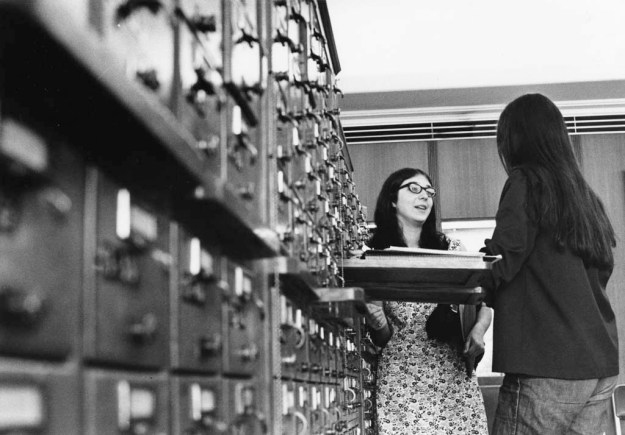 Students using library card catalog, 19??