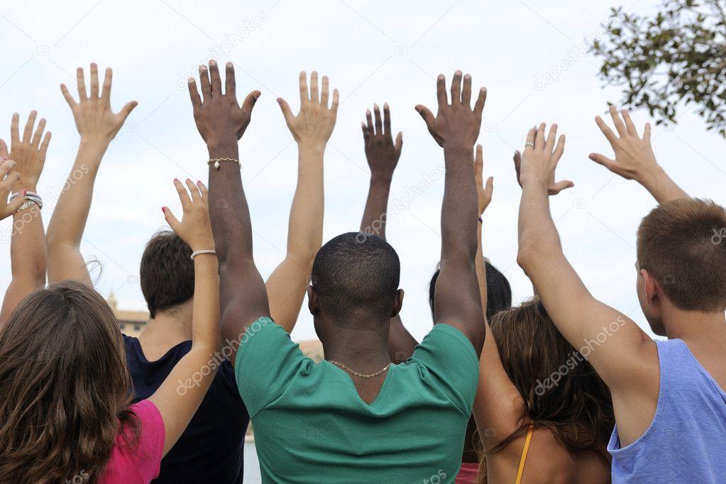 depositphotos_15545997-stock-photo-diverse-group-raising-hands