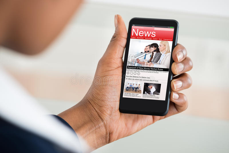 woman-reading-news-mobile-phone-close-up-s-hand-74154783