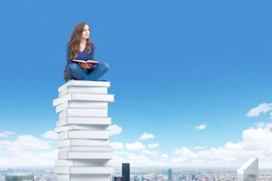 student-sitting-high-above-city