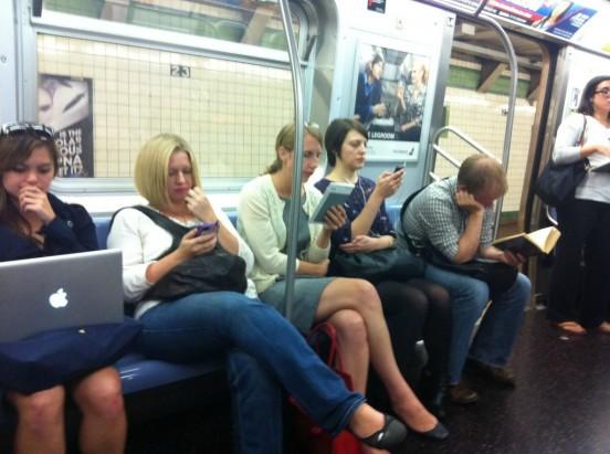 reading-books-ebooks-ipad-on-subway-1024x764-1