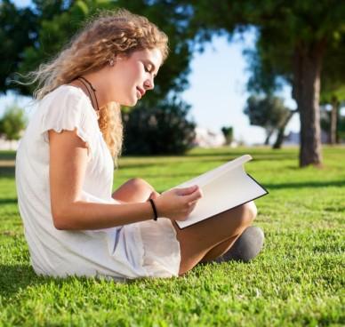 side-view-calm-woman-reading-park_1149-987