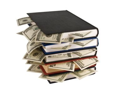 10116855 - money in books, isolated on white background